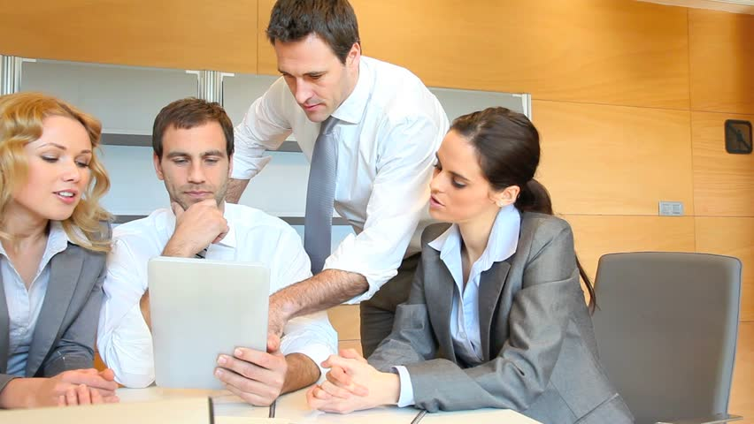 Group of business people meeting around table - HD stock video clip