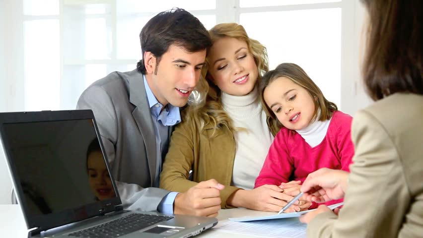 Family signing real-estate contract - HD stock video clip