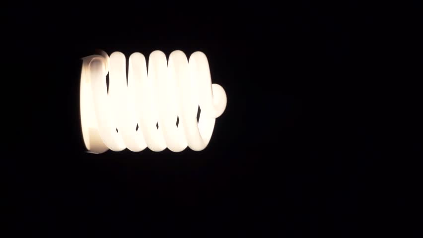 Light bulb glowing in dark | Shutterstock HD Video #19775176