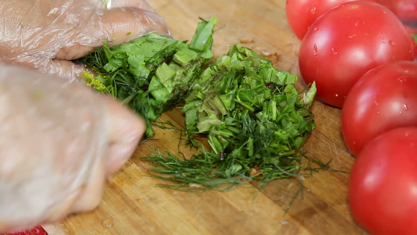 Dill and parsley being chopped #19777696
