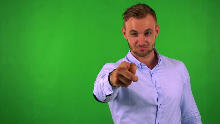Young handsome business man points to camera with finger - green screen - studio | Shutterstock HD Video #19832470