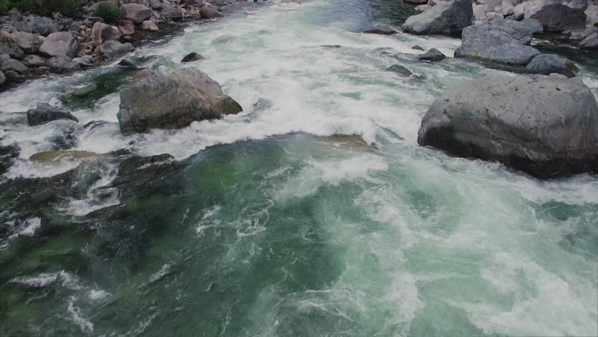 Drone Shot Flying Over Raging River in Mountain Forest #19836223
