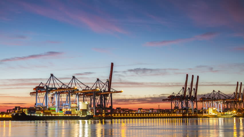 HAMBURG, GERMANY  September 9, 2016: Harbor container ship terminal in evening tilt timelapse Illuminated Hamburg container terminal with clouds on a sky time lapse | Shutterstock HD Video #19854259