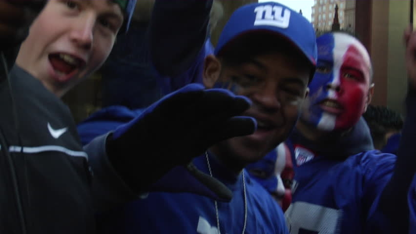 NEW YORK - FEBRUARY 7: Fans wait in anticipation of the ticker-tape parade in honor of the Super Bowl Champions New York Giants on February 7, 2011 in New York.  - HD stock video clip