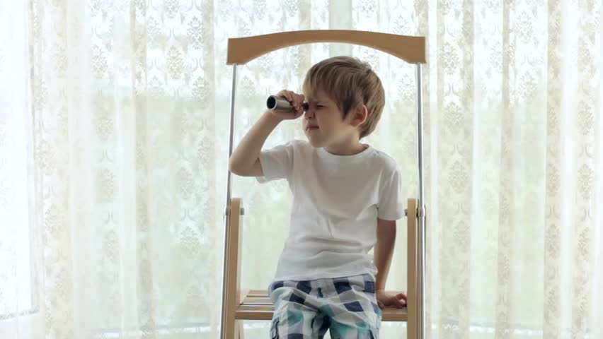 Boy Sitting at Home on a Ladder and Looking Through a Telescope #19933108