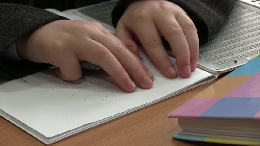 Kid Reading Braille. The child learns to read Braille on a sheet of paper sitting at the desk in the school | Shutterstock HD Video #19949605
