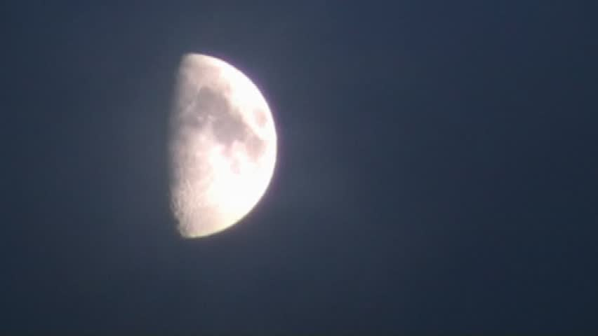 Moon (Half moon wrapped in dark clouds on a windy day - tele shot)