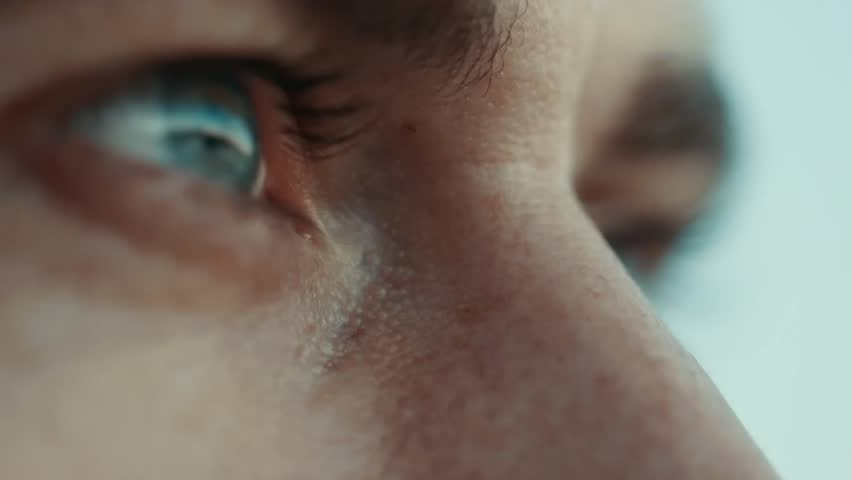 Eyes close up. the man watches a sunset.