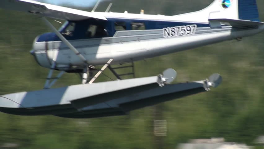 ALASKA, USA - CIRCA 2011; Blue float-plane coming in for a landing - HD stock footage clip