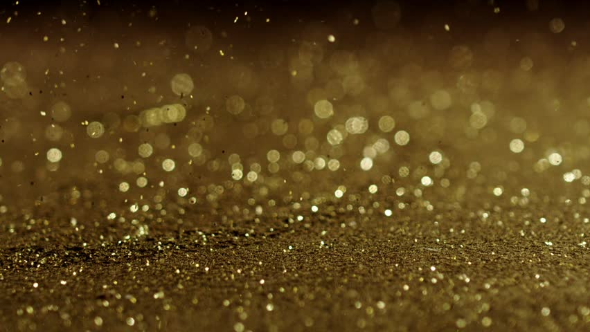 Golden glitter exploding , Red Epic slow motion clip | Shutterstock HD Video #20265541