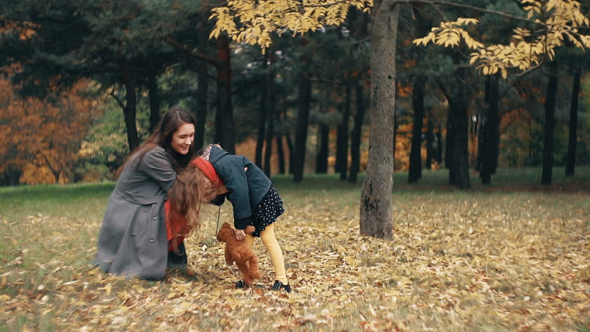 Cute funny little girl having fun with mom in the amazing autumn park slow motion | Shutterstock HD Video #20282344
