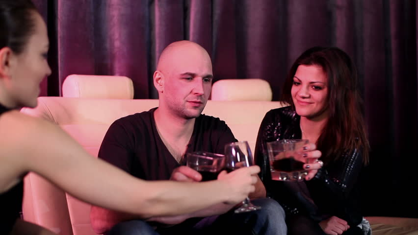 Young friends chatting and drinking in a nightclub, camera stabilizer shot - HD stock footage clip