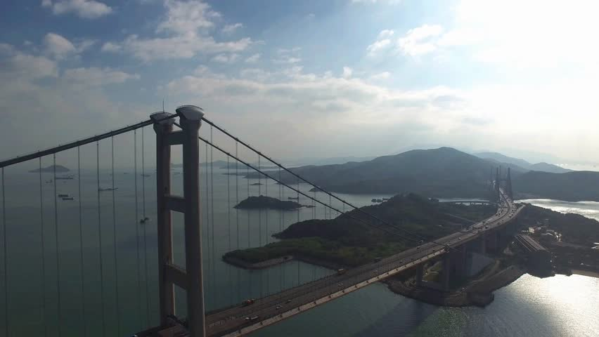 An aerial view fly over Tsing Ma Bridge under sunny day | Shutterstock HD Video #20423950