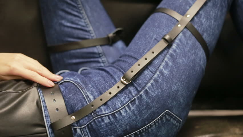 Girl in jeans with leather garter new fashion trends. straps on the hips | Shutterstock HD Video #20484763