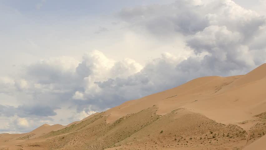 Clouds over the Gobi desert, dune Hongoryn, Mongolia. Full HD.   Shutterstock HD Video #20509333