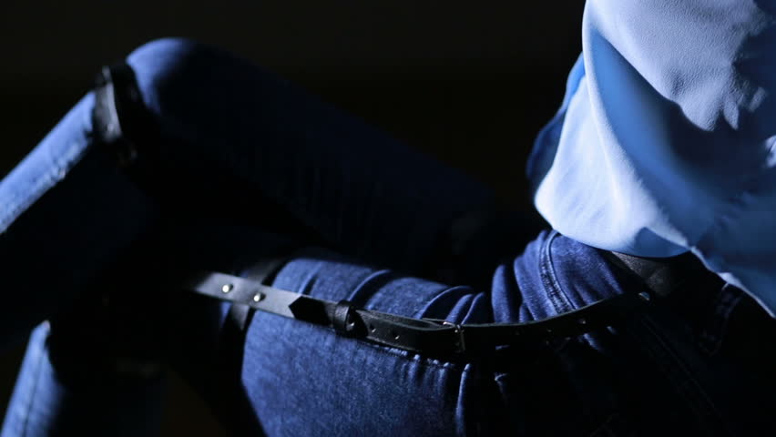 Girl in jeans with leather garter new fashion trends. straps on the hips | Shutterstock HD Video #20546656