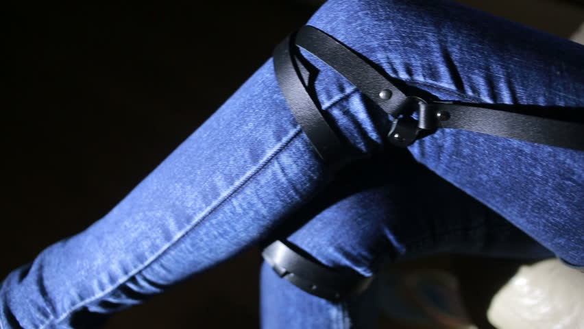 Girl in jeans with leather garter new fashion trends. straps on the hips | Shutterstock HD Video #20546692