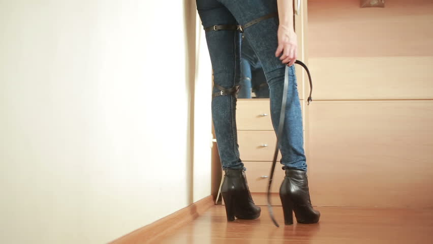 Girl in jeans with leather garter new fashion trends. straps on the hips | Shutterstock HD Video #20546701