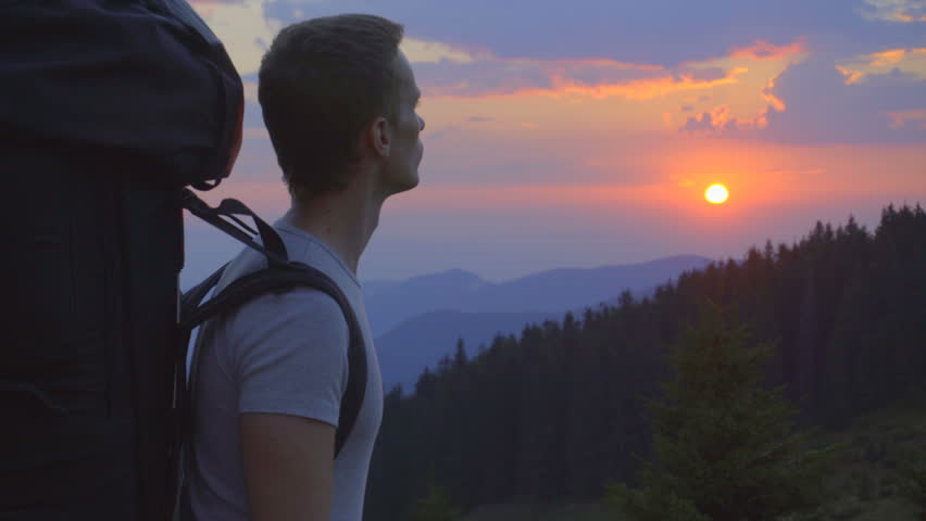 3 in 1 video! The handsome man stand on the mountain against the background of sunset. Real time capture. Wide angle  #20550526