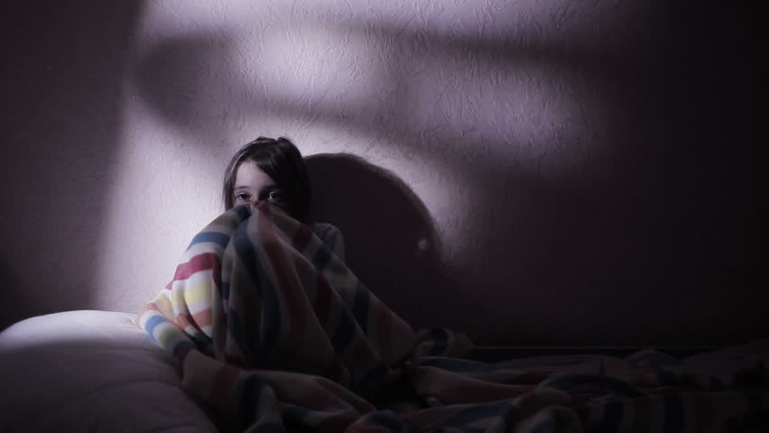 Girl under the covers in the night afraid of ghosts. nightmares. | Shutterstock HD Video #20556808