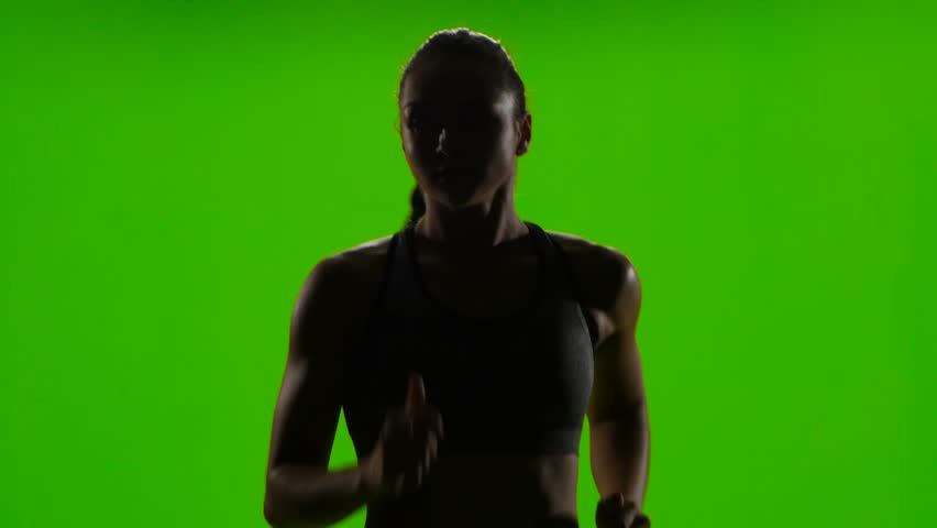 Athletic woman is jogging. Front view. Green screen | Shutterstock HD Video #20573026