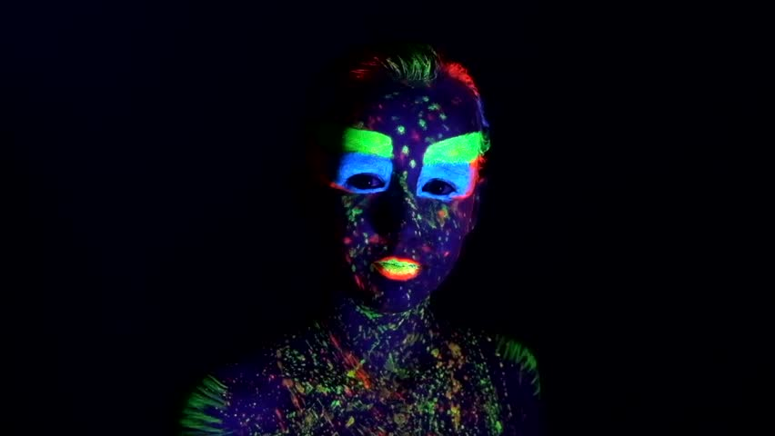 Portrait of beautiful girl with ultraviolet paint on her face. Girl with neon make-up in color light. | Shutterstock HD Video #20613427