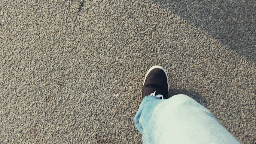 Walking in jeans with casual shoes on road, POV   | Shutterstock HD Video #20617063