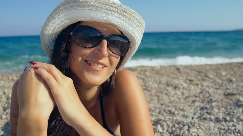 Smiling beautiful woman sunbathing on a beach | Shutterstock HD Video #20660587
