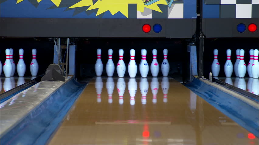 Bowling Inserts halfway down bowling lane 10 pins standing then see gray marble ball make strike, resets then knocks down 9 then makes spare sports playback, winner