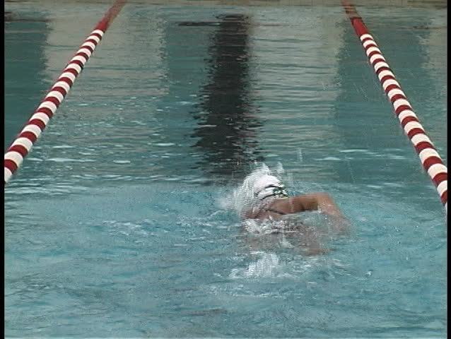 competitive swimmer practicing laps in a pool - SD stock video clip