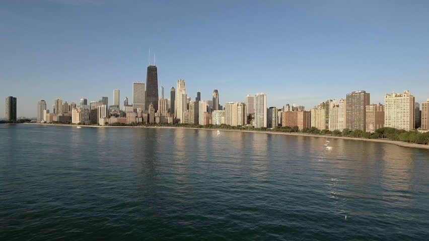 Aerial above the water to reveal Chicago Downtown, United States | Shutterstock HD Video #20873680