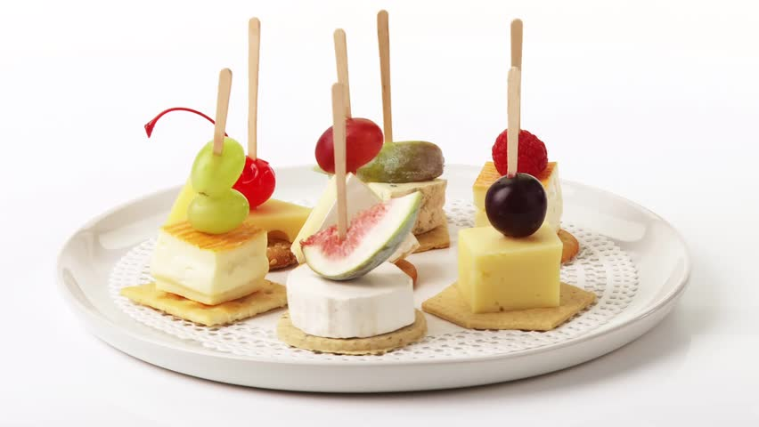 Cheese and fruit on cocktail sticks on crackers stock for Canape cocktail sticks