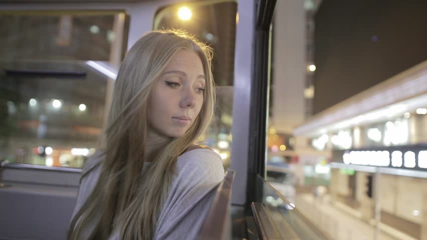 Young blonde attractive woman on a public double decked tram and looking from the window in Hong Kong. City lights in Hong Kong.  | Shutterstock HD Video #20963824