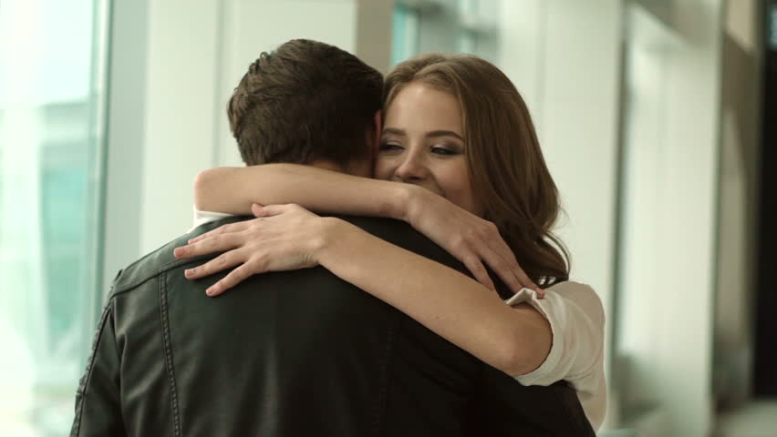 Couple meeting at the airport. boyfriend hugging his girlfriend. real emotion | Shutterstock HD Video #20990266