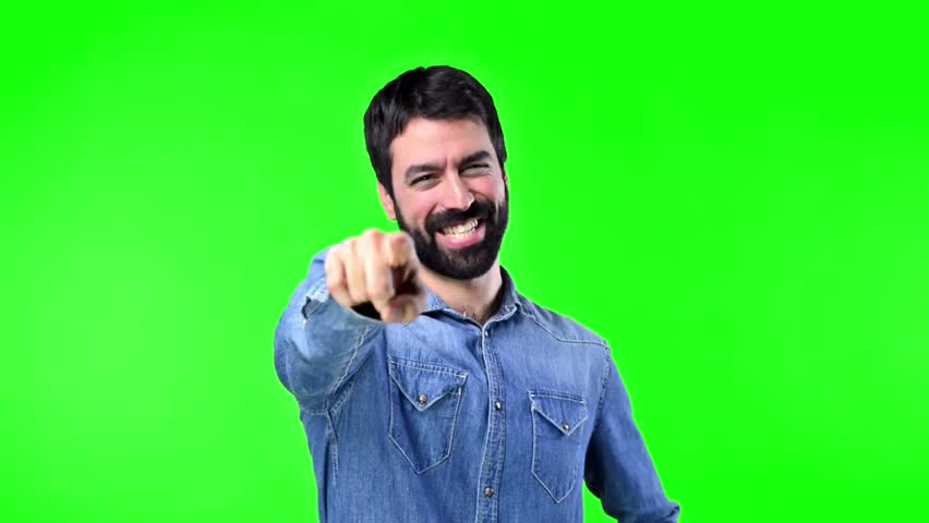 Man pointing to the front on green screen chroma key | Shutterstock HD Video #21035833