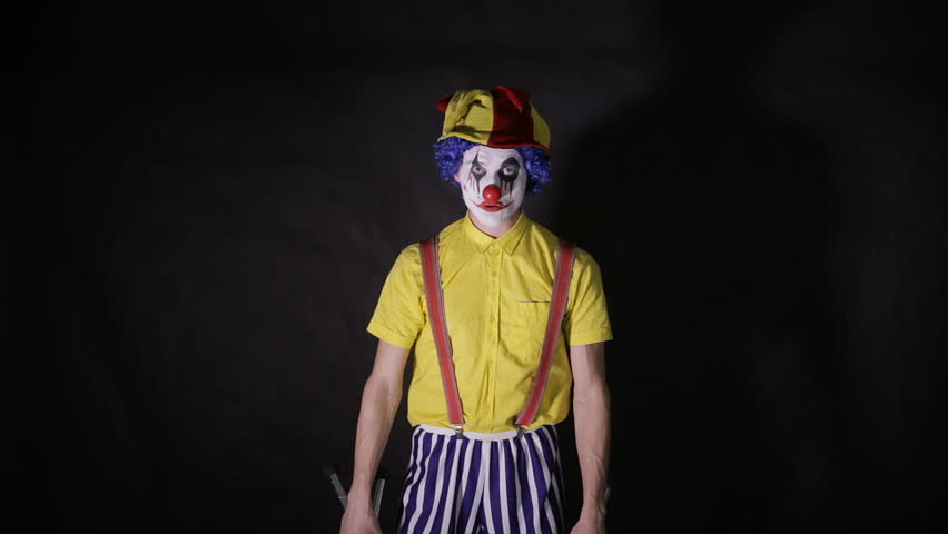 Scary mad Juggler clown using juggling pins. Terrible horror clown. | Shutterstock HD Video #21052339