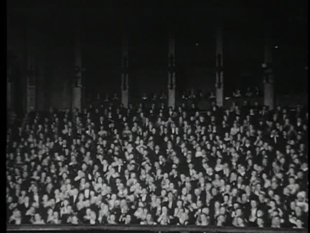Audience in theater applauding