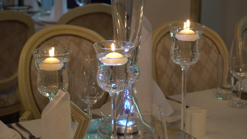Candles Burn in High Transparent Candlesticks, Three Candles in a Beautiful Setting, Candlesticks on Thin High Legs, 4k | Shutterstock HD Video #21203854