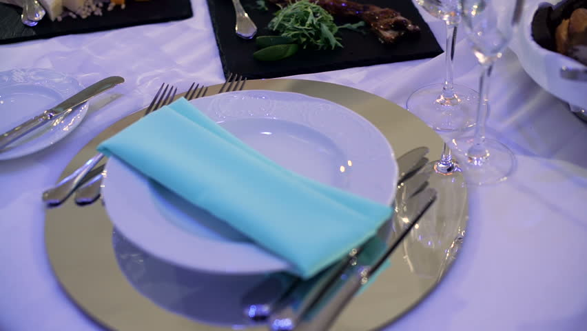 Plate with a blue napkin and silverware on the holiday table   Shutterstock HD Video #21284629