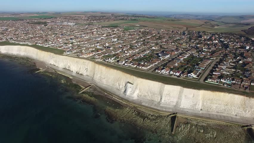 Aerial view of Peacehaven, East Sussex, a small seaside town build on the chalk cliffs of the South Downs after the Great War | Shutterstock HD Video #21295402
