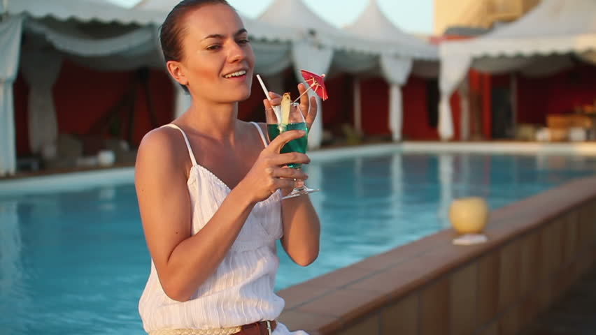 Happy Woman Drinking Exotic Cocktail By Swimming Pool Stock Footage Video 2130992 Shutterstock