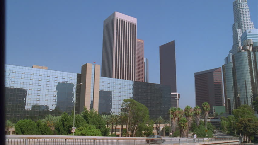 Day High angle Pan right over office buildings skyline freeway Palms Los Angeles | Shutterstock HD Video #21328027