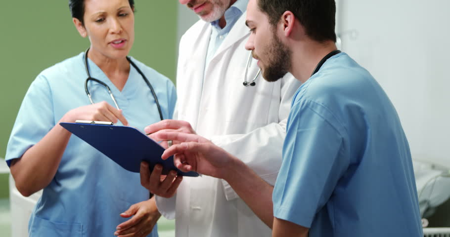 Three doctors discussing over digital tablet at the hospital | Shutterstock HD Video #21346594