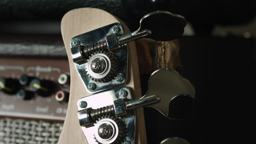 Somebody detune bass guitar, prank   Shutterstock HD Video #21361687