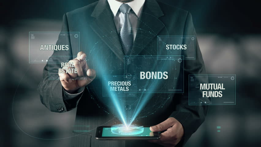 Businessman with Investment concept choose Real Estate from Atiques Metals Bonds Stocks Mutual Funds using digital tablet