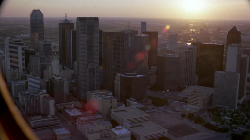 SUNSET Aerial city Circles around Dallas skyline tall office buildings, right left Sun peeks thru | Shutterstock HD Video #21545071