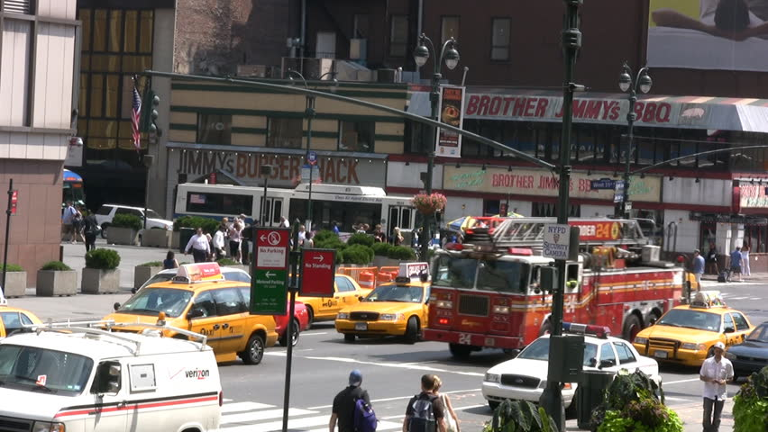 New York City Fire Truck Racing Through Rush Hour Traffic. With Siren Sound. Part 1 of 2 Clips - HD stock footage clip