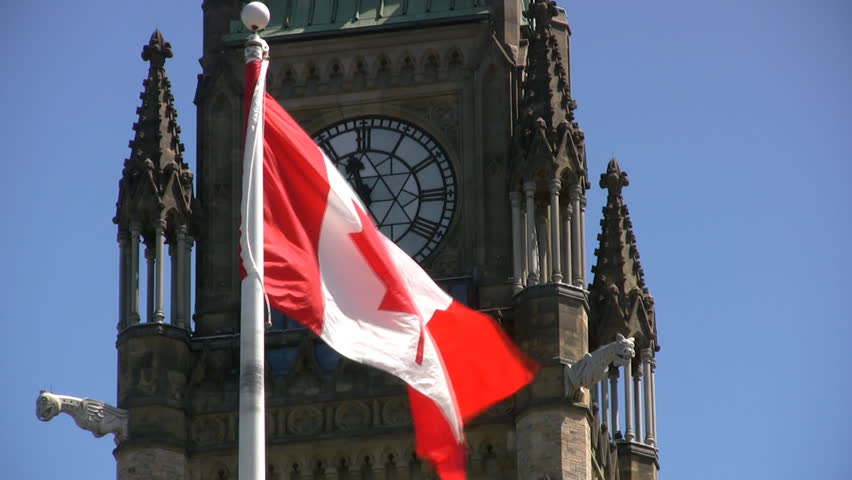 Canadian Maple Leaf Flag Flying On Parliament Hill, With The Peace Tower Behind. Ottawa, Ontario,Canada