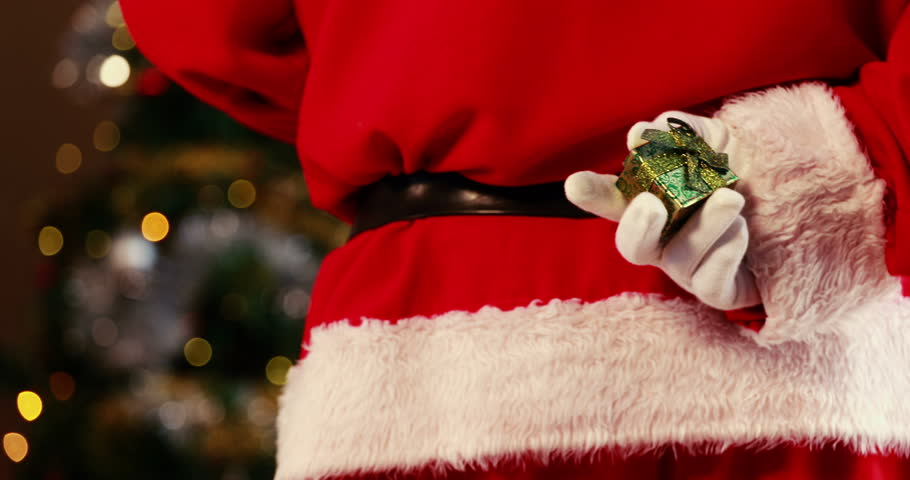 Closeup Of Santa Claus Writing Christmas List On Scroll