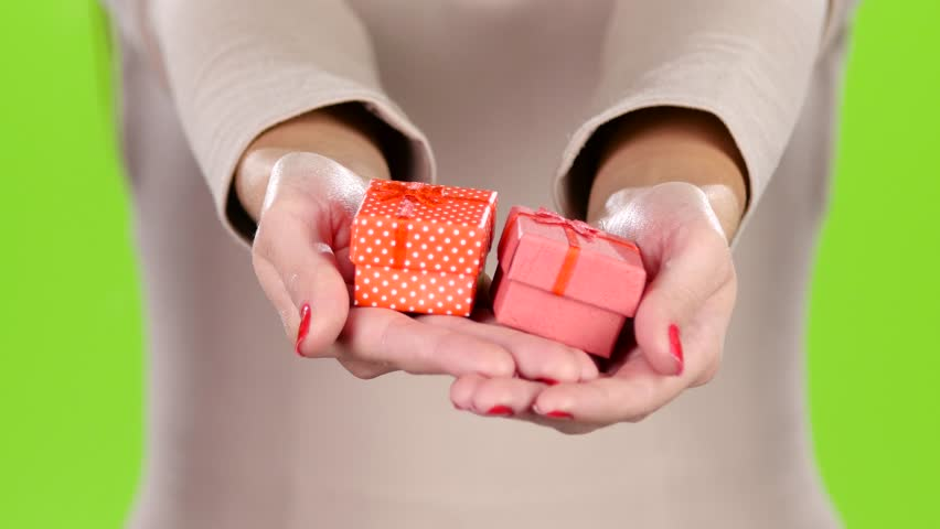 Two lovely gift in the hands of women. Close up | Shutterstock HD Video #21692329